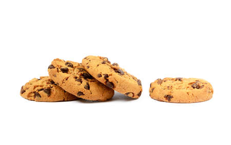fattening: Cookies with chocolate pieces isolated on white background
