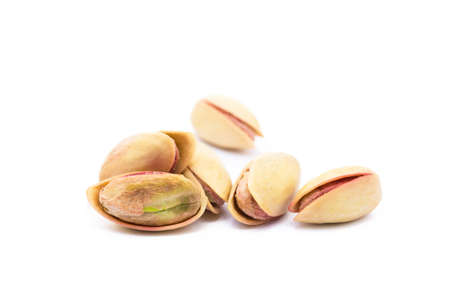 Pista of roasted pistachios isolated on white background