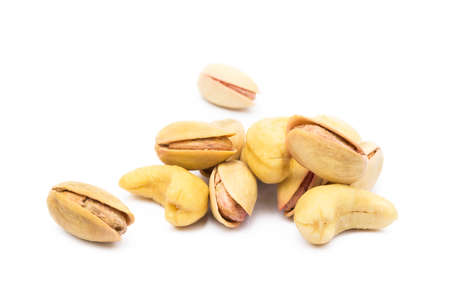 Pista of roasted pistachios and cashew isolated on white background