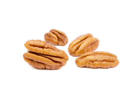 Fresh pecan nuts isolated on white background