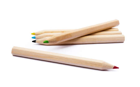 Wooden colored pencils isolated on white background
