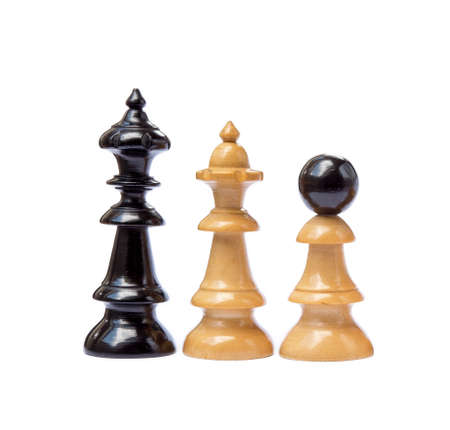 Old chess pieces isolated on white background