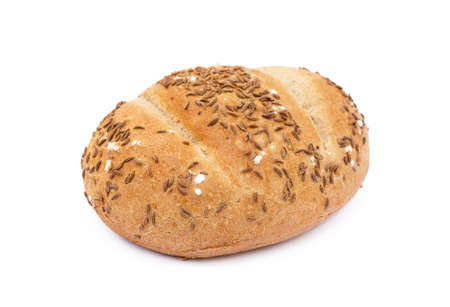 Crispy bun sprinkled with caraway isolated on white background Фото со стока