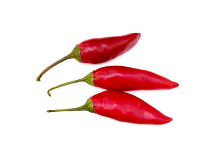 Red hot peppers isolated on white background Imagens