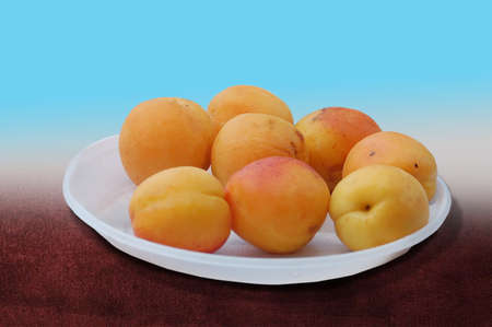 a dish with fresh and sweet apricots photo