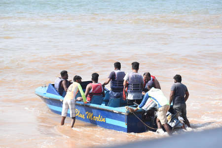 People ready to go for a ride in speed boat in Anjuna beach,Goa,India.14.12.2020.