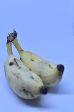 Cheru pazham or Njalipoovan (a variety of small banana fruit) against a white background.