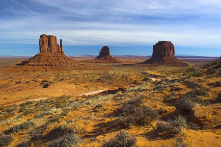 Semi-desert and the red rocks of the Navajo National Monument with on the background of the famous table mountains Stock Photo