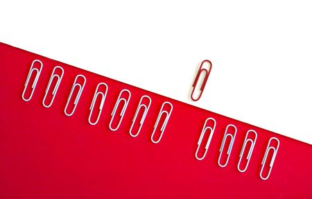 overcoming adversity: Paperclip arranged on white and red backgrounds to symbolize overcoming adversity, thinking outside the box, achievement, breakthrough.