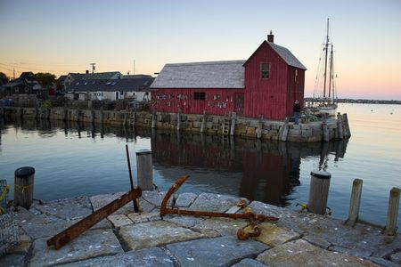 shack: Most photographed famous fishing shack in Bearskin Neck Wharf in New England on the background with antique anchors on the foreground.