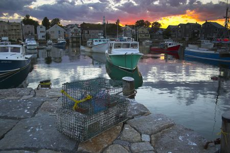 Most photographed famous fishing shack in Bearskin Neck Wharf in New England on the background with antique anchors on the foreground. photo