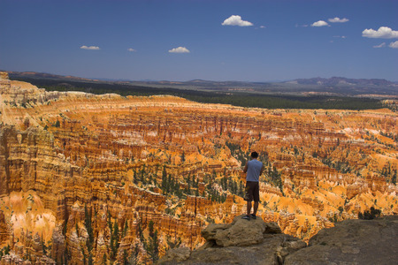 Tourists near rare rock formations of Bryce Canyon National park photo