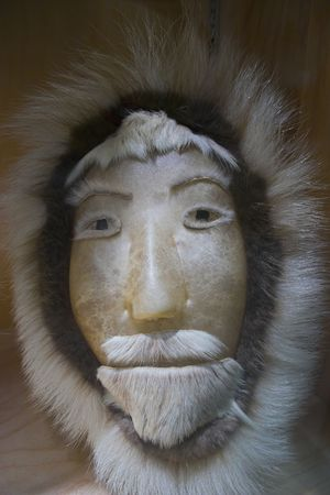 Traditional eskimo mask made of skin and fur Stock Photo