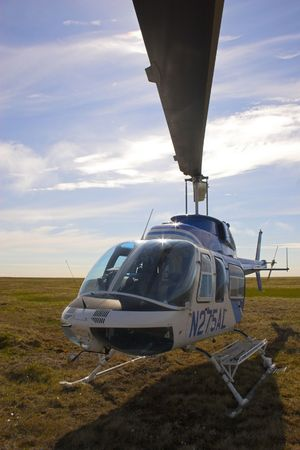 Helicopter in arctic tundra during polar summer