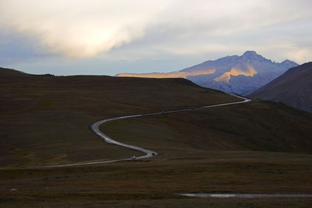 Nighttime roads in Cordeliers surrounded by dark mountains and tundra photo