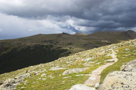 alpine tundra: Alpine tundra trail under thunder clouds