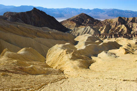 borax: Desert landscape with multicolored yellow clay and salt mineral deposits in geological formations of Death Valley National Park Stock Photo