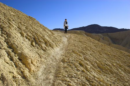 Desert landscape with multicolored yellow clay and salt mineral deposits in geological formations of Death Valley National Park Stock Photo