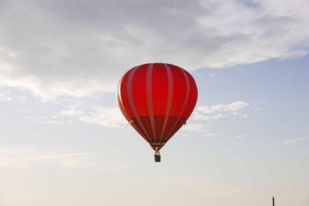 levitate: Red hot air balloon over farm fields near Omaha Nebraska Stock Photo