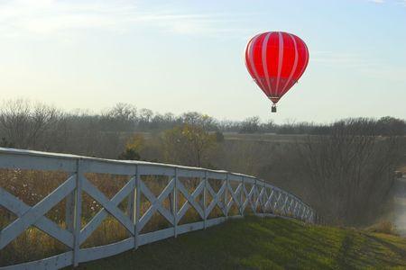 Red hot air balloon over farm fields near Omaha Nebraska Stock Photo