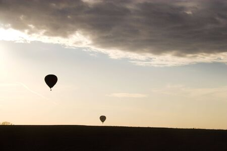 buoyant: Red hot air balloon over farm fields near Omaha Nebraska Stock Photo
