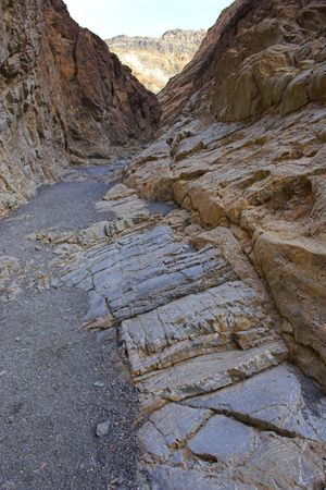 Blueish multicolored clay and salt mineral deposits in geological formations of Death Valley National Park