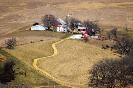 Aerial view of small farm and road in Iowa