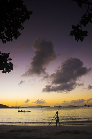 Sunset off the shore at equatorial island. Many of the photos in this series have been filtered using colored filters. photo