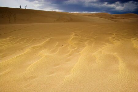 Thunder clouds, rain and sand are being blown over great sanddunes  photo