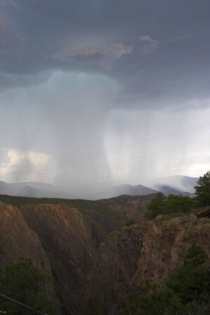 unusually: View from the top of Royal Gorge canyon on unusually heavy thunderstorm
