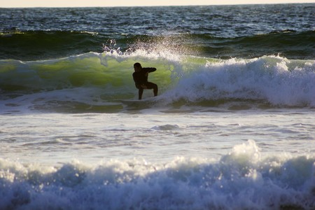 gliding: Surfers gliding on the waves of Baja California Stock Photo