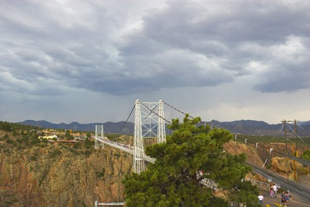 onset: Bridge over Royal Gorge canyon with an onset of storm