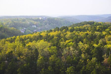 Ozark hills covered with mixed forest in the early fall Stock Photo