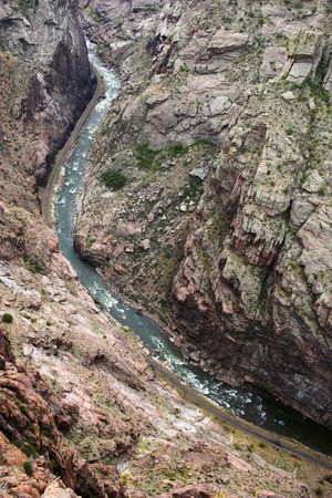 View down from the top of Royal Gorge canyon, kayakers in the mountain stream photo