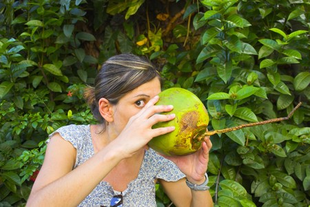 Girl with fresh coconut at the tropical island in Caribbean  Stock Photo
