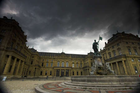 residence: Fa�ade of Wurzburg residence palace and dark clouds  Stock Photo