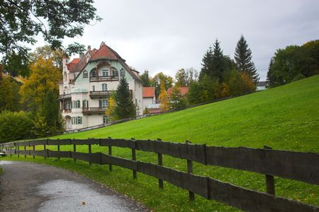 guesthouse: Beautiful Bavarian guesthouse and trail in woods Stock Photo