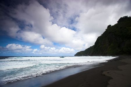 Sandy beach and ocean waves on Big Island