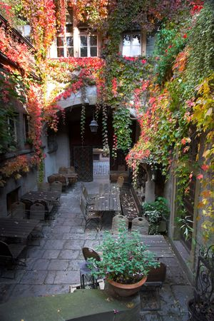 Beautiful courtyard and tables with red ivy in Bavaria