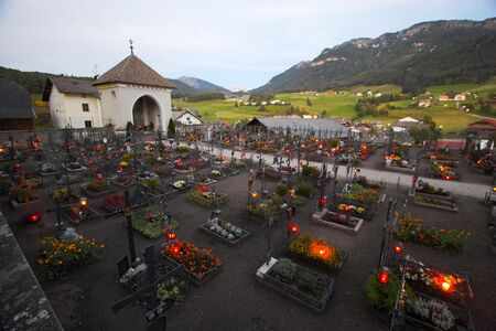 christian altar: Alpine cemetery in Castelrotto, Italy at night