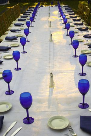 set up: Table set up with blue accessories for reception and formal meal outdoors
