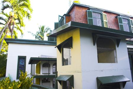 Antique Ernest Hemingway museum building and garden in Key West, Florida photo