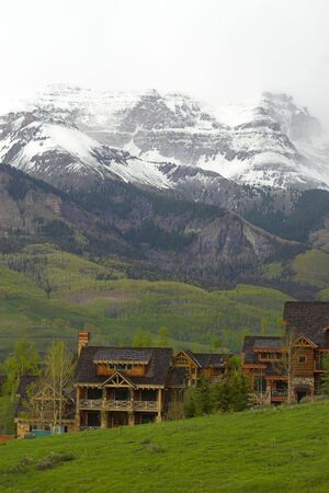 Log houses built high up in the mountains photo