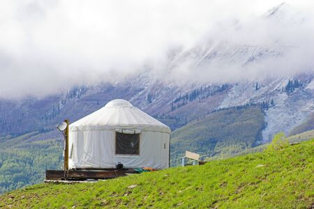 the dwelling: White yurt dwelling situated in Colorado mountains