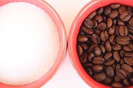 The cups full of coffee beans and sugars on light background  photo