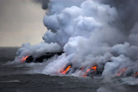 magma: Lava erupting into Pacific Ocean during evening on Big Island