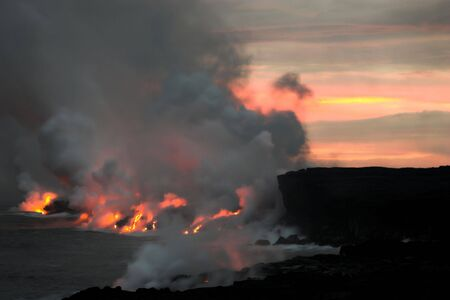 Lava erupting into Pacific Ocean at night on Big Island photo