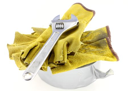 crescent wrench: Duct tape with crescent wrench and construction gloves on white background Stock Photo