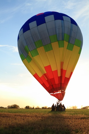 landed: Hot Air balloon landed in the field at dawn Stock Photo