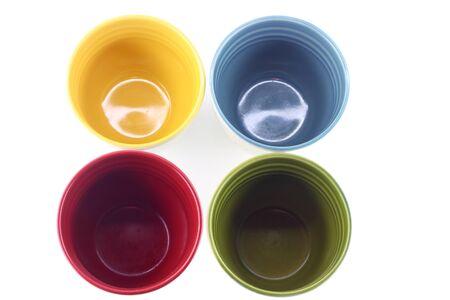 Four tea cups on the white background Banco de Imagens